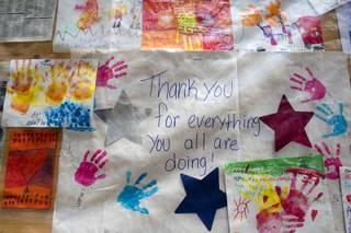 Thank you posters are displayed on an information board at Centennial High School Sunday, July 14, 2013.