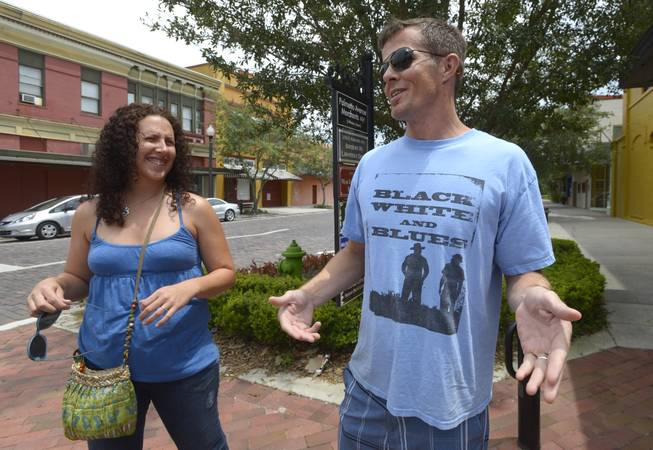 Kirk O'Neal, right, and Storey Book, of Orlando, Fla., talk about the outcome of the George Zimmerman trial while visiting the downtown area of Sanford, Fla., Sunday, July 14, 2013. Zimmerman, a former neighborhood watch volunteer, was found not guilty in the 2012 shooting death of Trayvon Martin.