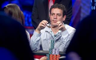 Carlos Mortensen of Spain, 2001 main event winner, competes during the seventh day of the World Series of Poker $10,000 buy-in no-limit Texas Hold 'Em at the Rio Monday, July 15, 2013.