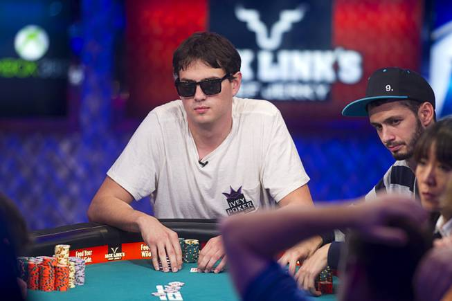 Mark Newhouse of Las Vegas competes during the seventh day of the World Series of Poker $10,000 buy-in no-limit Texas Hold 'Em at the Rio Monday, July 15, 2013.