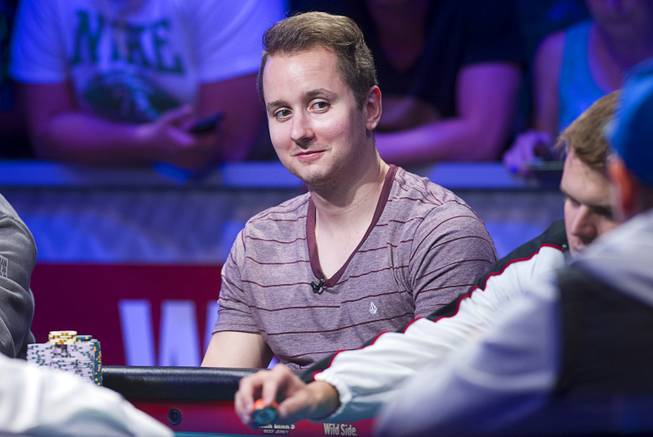 Canadian Marc McLaughlin of competes during the seventh day of the World Series of Poker $10,000 buy-in no-limit Texas Hold 'Em at the Rio Monday, July 15, 2013.