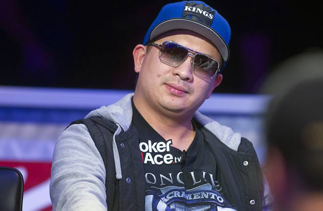 JC Tran of Sacramento, Calif. competes during the seventh day of the World Series of Poker $10,000 buy-in no-limit Texas Hold 'Em at the Rio Monday, July 15, 2013.
