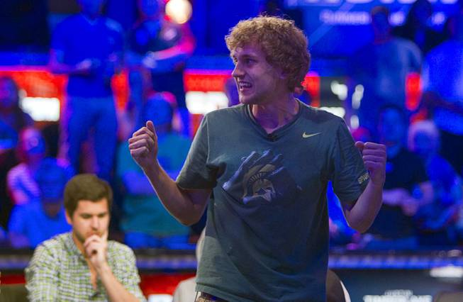 Ryan Riess of East Lansing, Mich. celebrates after winning a hand and knocking out Rep Porter of Woodinville, Wash. during the World Series of Poker $10,000 buy-in no-limit Texas Hold 'Em main event at the Rio Tuesday morning, July 16, 2013.