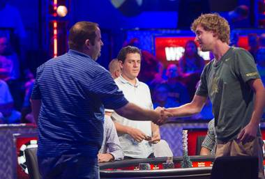 Ryan Riess, right, of East Lansing, Mich. shakes hands with Rep Porter of Woodinville, Wash. after knocking Porter out of the World Series of Poker $10,000 buy-in no-limit Texas Hold 'Em main event at the Rio Tuesday morning, July 16, 2013.