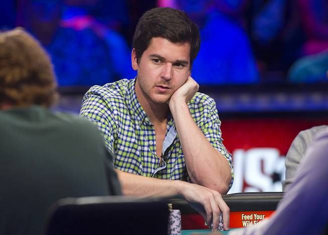 David Benefield of Arlington, Texas competes during the seventh day of the World Series of Poker $10,000 buy-in no-limit Texas Hold 'Em at the Rio Monday, July 15, 2013.