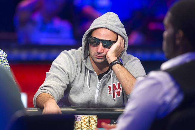 Sylvain Loosli of France competes during the seventh day of the World Series of Poker $10,000 buy-in no-limit Texas Hold 'Em at the Rio Monday, July 15, 2013.