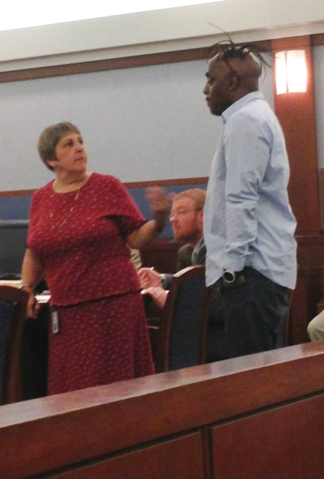 Laurie Diefenbach of the Clark County Public Defender's Office talks with rapper Coolio during his court appearance on a domestic violence charge. Diefenbach showed Coolio the deal offered by the prosecution as a friend of the court. Coolio refused the offer and was given 30 days to decide if he would like to represent himself in the case.