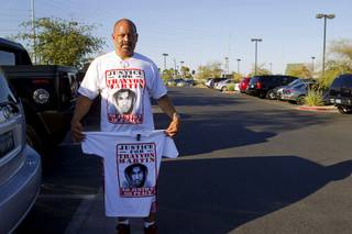 Eddie E. poses with a Trayvon Martin T-shirt before a town hall discussion at the Pearson Community Center in North Las Vegas Wednesday, July 17, 2013. The discussion, titled After Trayvon Martin: What Now?, attracted more than 200 people. The Phi Beta Sigma fraternity sponsored the event.