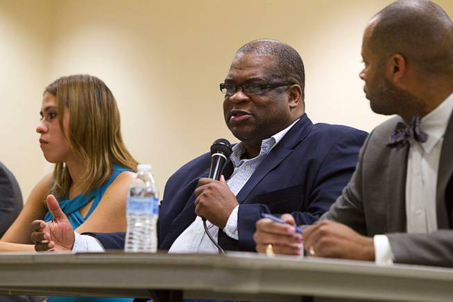 Pastor Robert E. Fowler Sr., center, of Victory Missionary Baptist Church, speaks during a town hall discussion at the Pearson Community Center in North Las Vegas Wednesday, July 17, 2013. The discussion, titled After Trayvon Martin: What Now?, attracted more than 200 people. The Phi Beta Sigma fraternity sponsored the event.