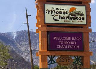 A Resort at Mount Charleston sign board sends a welcome to visitors Thursday, July 18, 2013. The mountain is expected to reopen to the public on Friday.