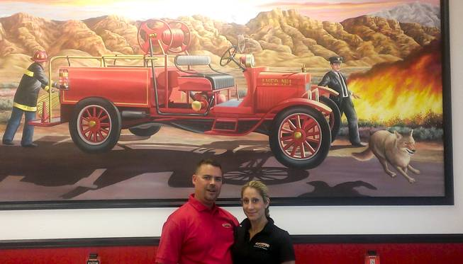 Kris and Kelley Fleck owners of hte Firehouse Subs on 7865 W. Sahara Ave pose in their restaurant's lobby.