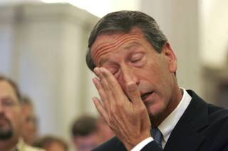 South Carolina Gov. Mark Sanford wipes his tears as he admitted to having an affair during a news conference Wednesday, June 24, 2009, and was the reason why he was in Argentina.  He also announce that he is resigning as chairman of the Republican Governors Association.