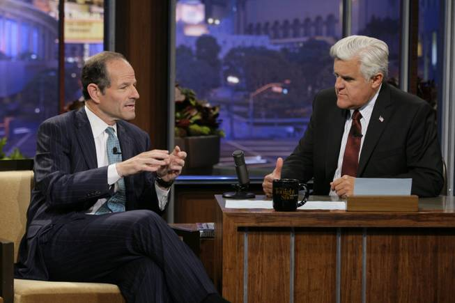 "This publicity image released by NBC shows former New York Gov. Eliot Spitzer, left, talking with host Jay Leno during a taping of ""The Tonight Show with Jay Leno,"" Friday, July 12, 2013, in Burbank, Calif. Spitzer, who resigned as governor in 2008 amid a prostitution scandal, is now running for New York City comptroller."