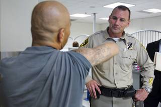 An inmate shows a gang tattoo to Metro Corrections Captain Rich Suey during a tour of the Clark County Detention Center Tuesday, July 23, 2013.