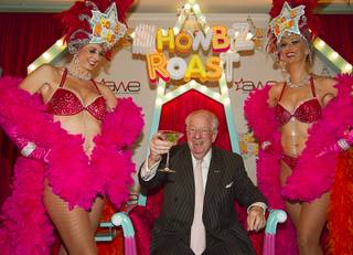 Former Las Vegas Oscar Goodman gives a toast after arriving for