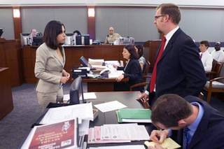 Deputy Public Defenders Nadia Hojjat, left, and Robert O'Brien confer in court Tuesday, July 23, 2013.