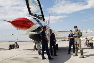 Maj. Blaine Jones gets ready to board his aircraft as the Thunderbirds resume limited flight operations at Nellis Air Force Base Tuesday, July 22, 2013 after having to stand down since April because of sequestration.