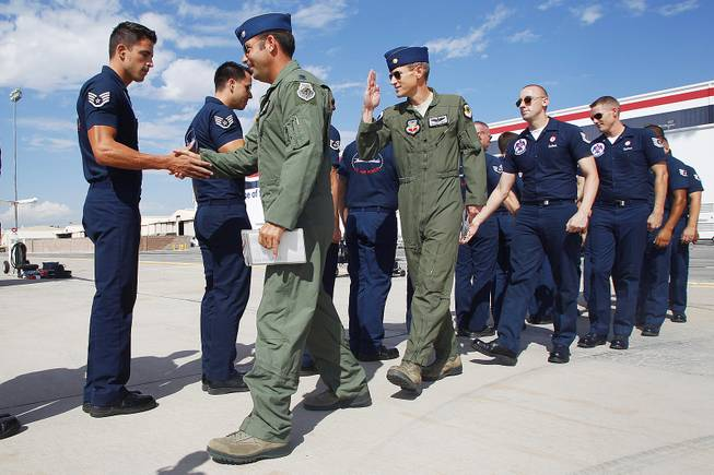Lt. Col. Greg Moseley, right, and Maj. Blaine Jones greet their flight crews as the Thunderbirds resume limited flight operations at Nellis Air Force Base Tuesday, July 22, 2013 after having to stand down since April because of sequestration.