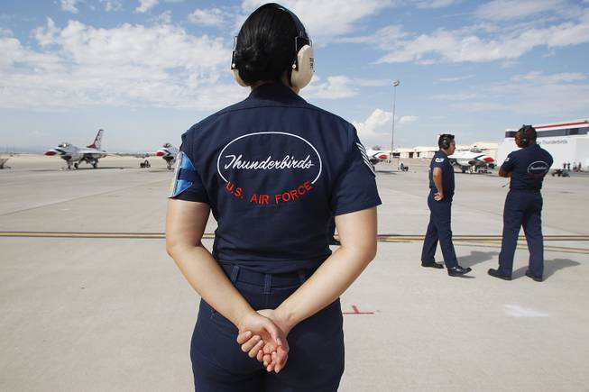 TSgt. Alice Diddle stands by as the Thunderbirds resume limited flight operations at Nellis Air Force Base Tuesday, July 22, 2013 after having to stand down since April because of sequestration.