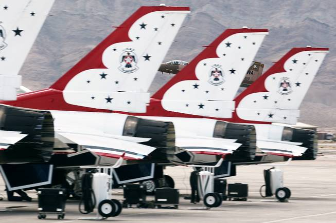 An F-15 attached to the 57th Wing based at Nellis Air Force Base is seen behind the tails of the Thunderbirds F-16's Tuesday, July 22, 2013.