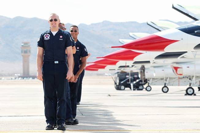 Flight crews line up to greet pilots as the Thunderbirds resume limited flight operations at Nellis Air Force Base Tuesday, July 22, 2013 after having to stand down since April because of sequestration.