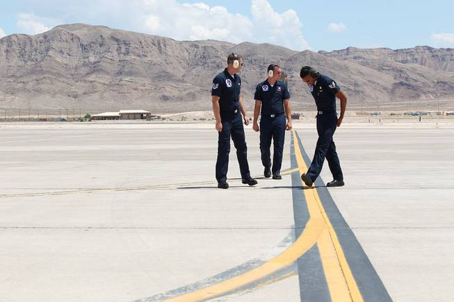 From left, SSgt. Richard Ingram and SSgt. Benjamin Ayivorh as the Thunderbirds resumed limited flight operations at Nellis Air Force Base Tuesday, July 22, 2013 after having to stand down since April because of sequestration.