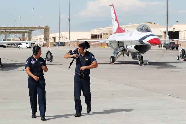 TSgt. Alicia Valenzuela, left, and TSgt. Manuel Martinez talk on the flight line as the Thunderbirds resume limited flight operations at Nellis Air Force Base Tuesday, July 22, 2013 after having to stand down since April because of sequestration.