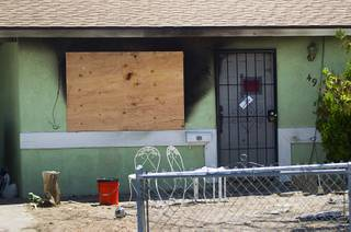 A home in Henderson is shown after a deadly fire Wednesday, July 24, 2013. Two people died in the fire, Henderson Fire officials said.