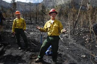 Hydrologist Brian Anderson and soil scientist Brad Rust, both from the U.S. Forest Service, speak to members of the media in a burned area near Cathedral Rock Wednesday, July 24, 2013 as a result of the recent fire on Mount Charleston.
