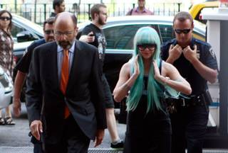 Amanda Bynes, accompanied by attorney Gerald Shargel, arrives for a court appearance in New York, Tuesday, July 9, 2013.