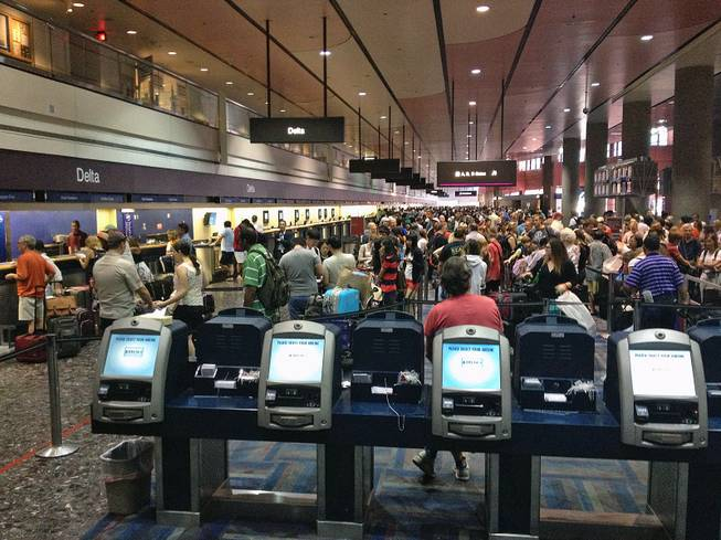 A computer problem caused long lines at ticket counters at McCarran International Airport in Las Vegas on Thursday, July 25, 2013.