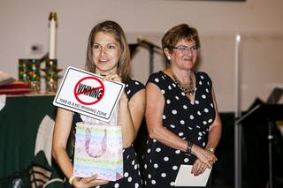 Intern Pastor Kaitlyn Ferguson, left, with the Rev. Marta Poling-Goldenne, co-pastor of New Song Church in Henderson, shows a gift she received at a farewell party at the church on Saturday, July 27, 2013. Ferguson will soon complete her one-year internship at the church.