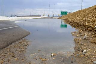Storm runoff covers the roadway at the Flamingo Road exit on I-215 Sunday, July 28, 2013. The exit was temporarily closed until the water receded.