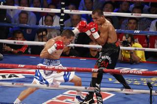 In this July 27, 2013, photo, Mexico's Juan Francisco Estrada, left, fights against Milan Melindo of the Philippines during their WBO/WBA Flyweight title match at the Cotai Arena in Venetian Macao in Macau. A Chinese fighters victory at a Macau showdown brings the worlds top casino market a step closer to challenging Las Vegas for dominance of another Sin City staple: big-time boxing matches. Macau, which long ago eclipsed Vegas as the world's top gambling city, is now looking to add to its allure by holding the kind of boxing bouts that Las Vegas is known for.