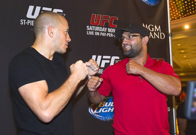 UFC welterweight champion Georges St. Pierre, left, of Canada and Johny Hendricks of Dallas, Texas pose during a UFC news conference in the lobby of the MGM Grand Monday, July 29, 2013. St. Pierre will defend his welterweight title against Hendricks during UFC 167 on Nov. 17 at the MGM Grand.