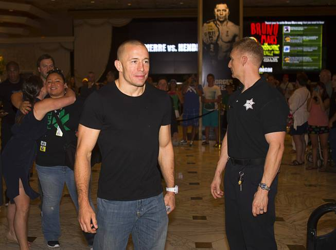 UFC welterweight champion Georges St. Pierre of Canada arrives for a UFC news conference in the lobby of the MGM Grand Monday, July 29, 2013. St. Pierre will defend his welterweight title against Johny Hendricks of Dallas, Texas during UFC 167 on Nov. 17 at the MGM Grand.
