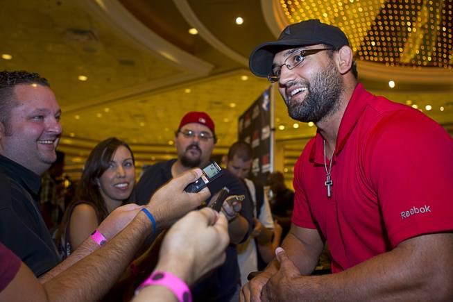 UFC fighter Johny Hendricks of Dallas, Texas talks with reporters during a UFC news conference in the lobby of the MGM Grand Monday, July 29, 2013.Hendricks will challenge UFC welterweight champion Georges St. Pierre of Canada for the title during UFC 167 on Nov. 17 at the MGM Grand.