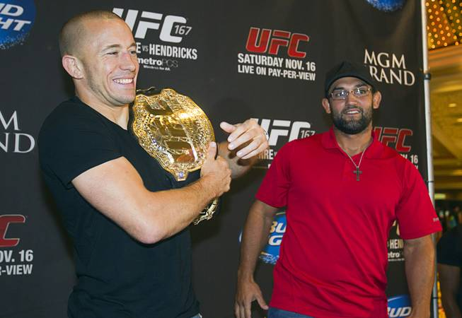 UFC welterweight champion Georges St. Pierre, left, of Canada poses Johny Hendricks of Dallas, Texas pose during a UFC news conference in the lobby of the MGM Grand Monday, July 29, 2013. St. Pierre will defend his welterweight title against Hendricks during UFC 167 on Nov. 17 at the MGM Grand.