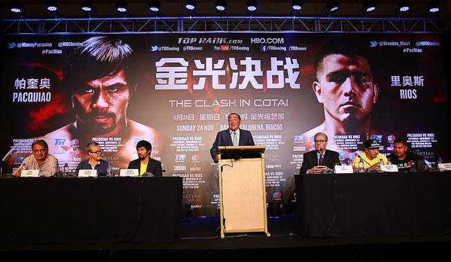 Manny Pacquiao and Brandon Rios listen as Top Rank promoter Bob Arum speaks during a news conference in Beijing, China, on Tuesday, July 30, 2013.