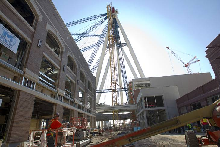 The 550-foot-tall High Roller observation wheel is shown under construction during a tour of Caesars Entertainment's Linq development Tuesday, July 29, 2013. The first phase of the $550 million shopping, dining and entertainment district is expected to open in late 2013. The High Roller is expected to open in 2014.