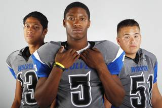 Basic High football players (from left) Pale Laulu, Antraye Johnson and Steven Lalli before the 2013 season.