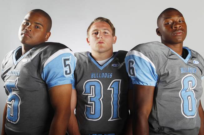 Centennial High School football players (from left) Toby Lopez, Josh Gray and Lantz Worthington before the 2013 season.