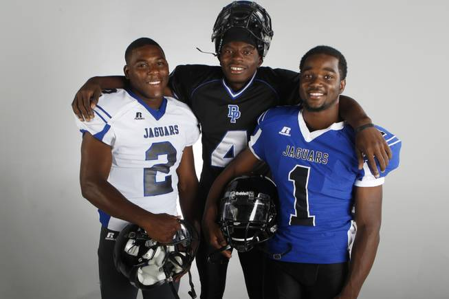 Desert Pines football players Eric Wilkes, Tim Hough and Malik Davis July 30, 2013.