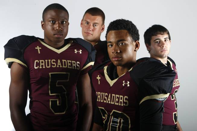 Faith Lutheran football players, from left, Danny Otuwa, Hayden Solis, Keenan Smith and Vinny DeGeorge July 30, 2013.