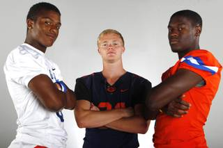 Bishop Gorman High football players (from left) Terrance Chambers, Dylan Weldon and Daniel Stewart.