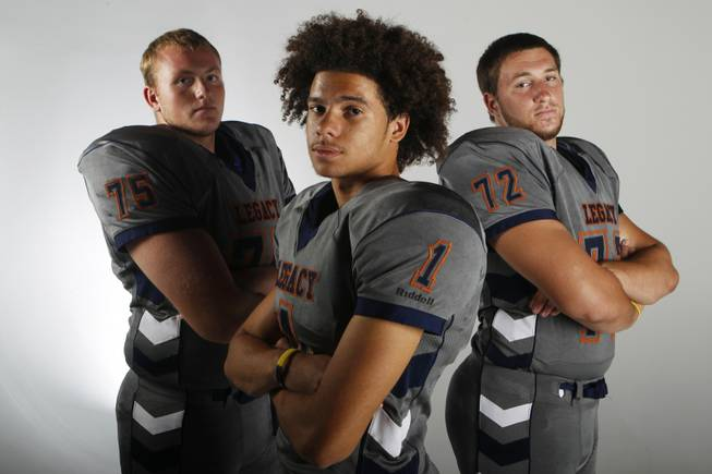 Legacy football players Matthew Sink, Devin Williams and Zach Lugris July 30, 2013.