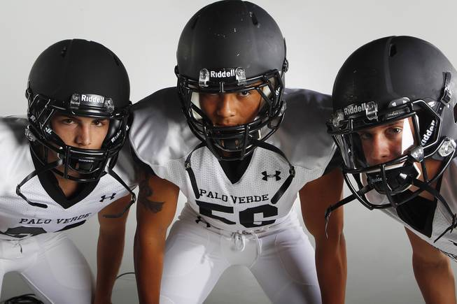 Palo Verde High football players (from left) Sean Dennis, Josh Hamilton and Parker Rost before the 2013 season.