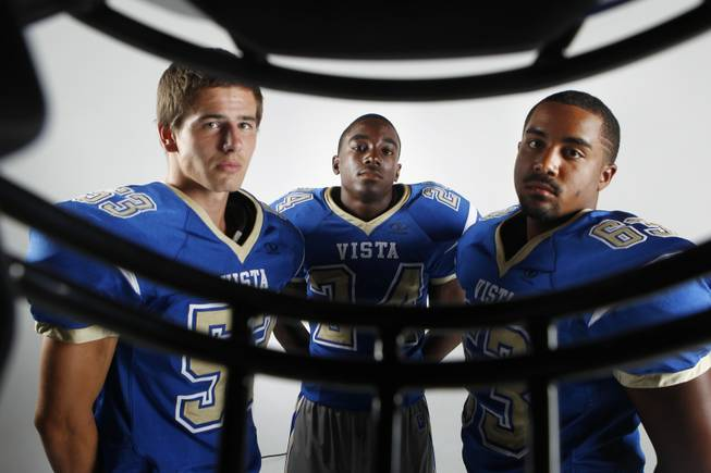 Sierra Vista football players Caleb Stiles, D.J. Lashaul and Deon Daswell July 30, 2013.