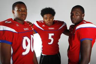 Valley High football players (from left) Noble Hall, Demarrius Oliver and Tyrone Prewitt before the 2013 season.