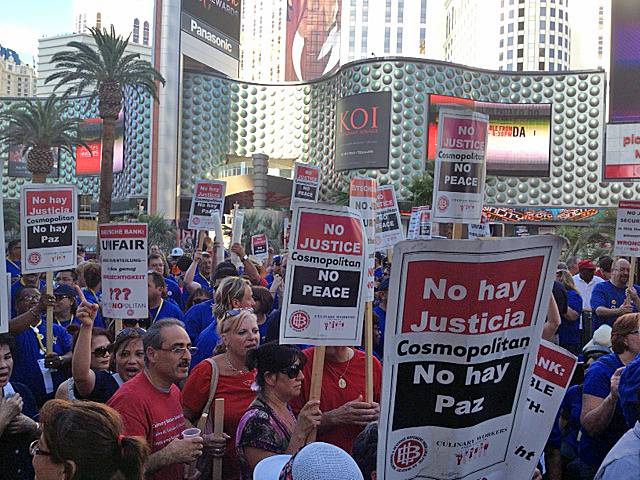 Members of the Culinary Union and California School Employees Association protest outside the Cosmopolitan, Wednesday, July 31, 2013.